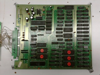 wood panel with a big mounted main board on it.