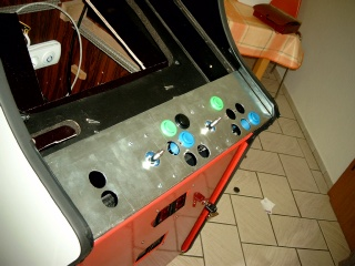 The panel of the arcade, temporary applied with some buttons and joysticks.